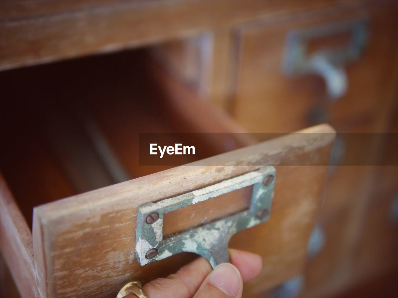 Close-Up Of Person Hand Opening Drawer