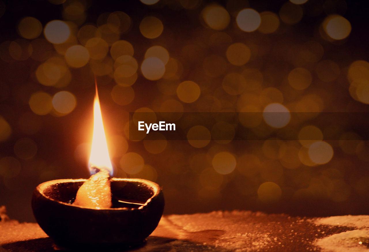 Close-Up Of Burning Diya At Night