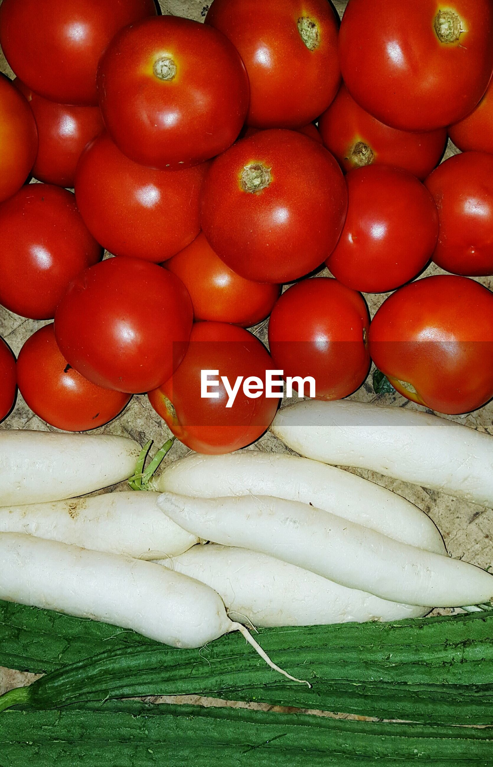 Directly above view of fresh organic vegetables at market stall