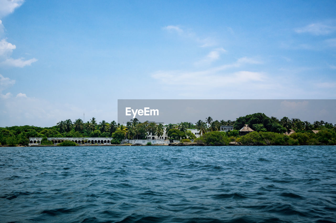 water, sky, waterfront, cloud - sky, beauty in nature, scenics - nature, sea, plant, tree, tranquil scene, nature, tranquility, no people, architecture, day, built structure, building, idyllic, outdoors