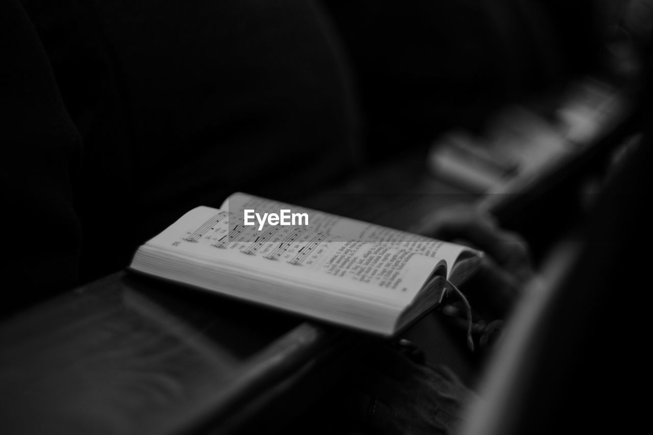 Close-up of open book on table at church