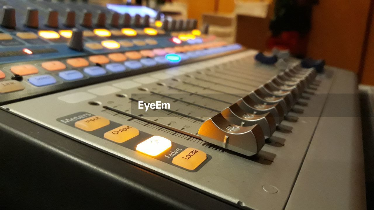 illuminated, sound mixer, technology, indoors, no people, sound recording equipment, close-up, recording studio, focus on foreground, control panel, mixing, day