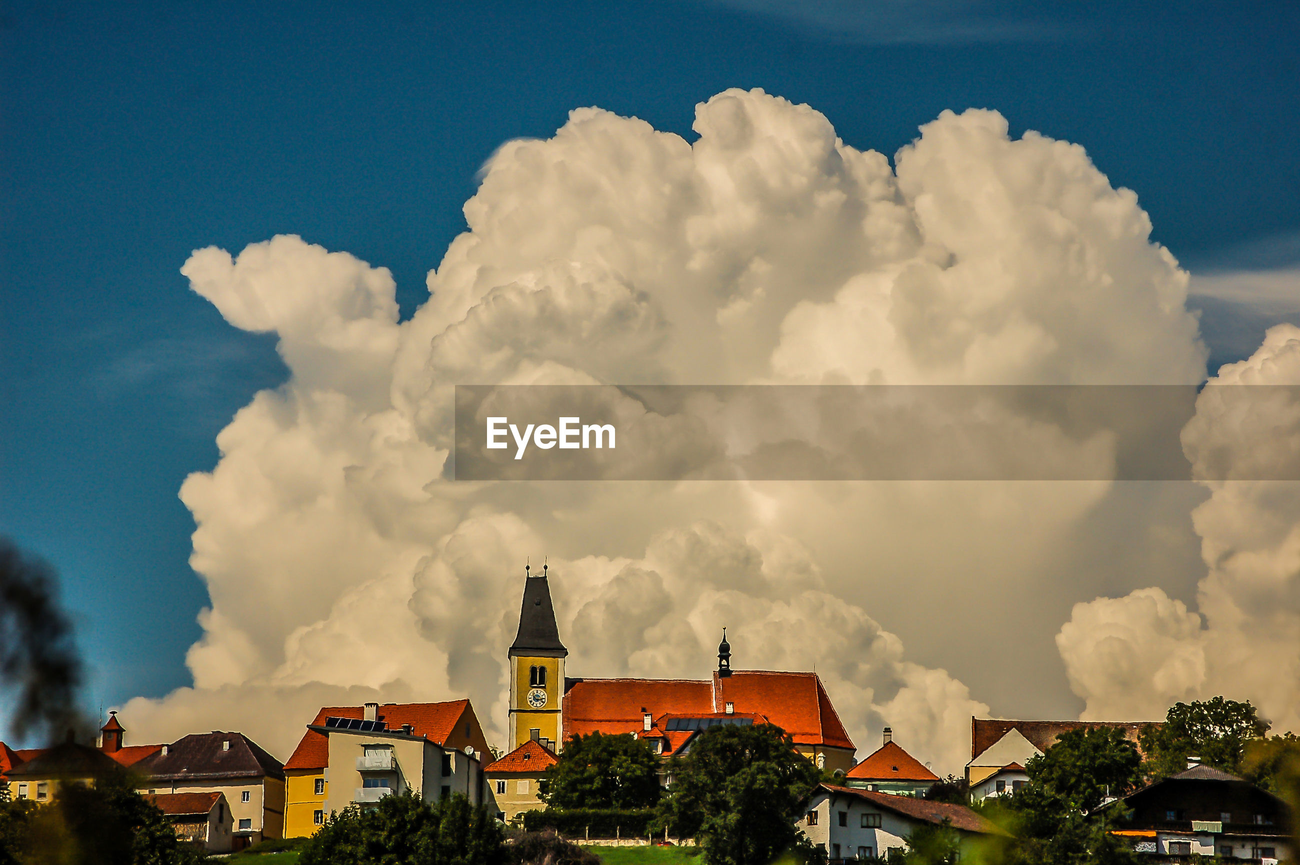 HOUSES AND CITYSCAPE AGAINST SKY