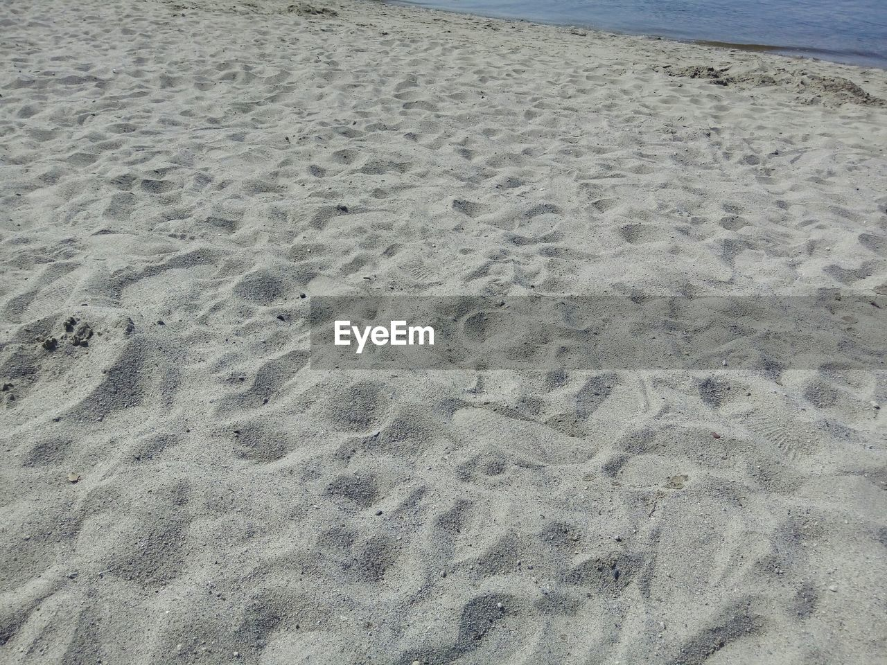 sand, beach, shore, nature, sea, no people, pattern, day, outdoors, water, beauty in nature