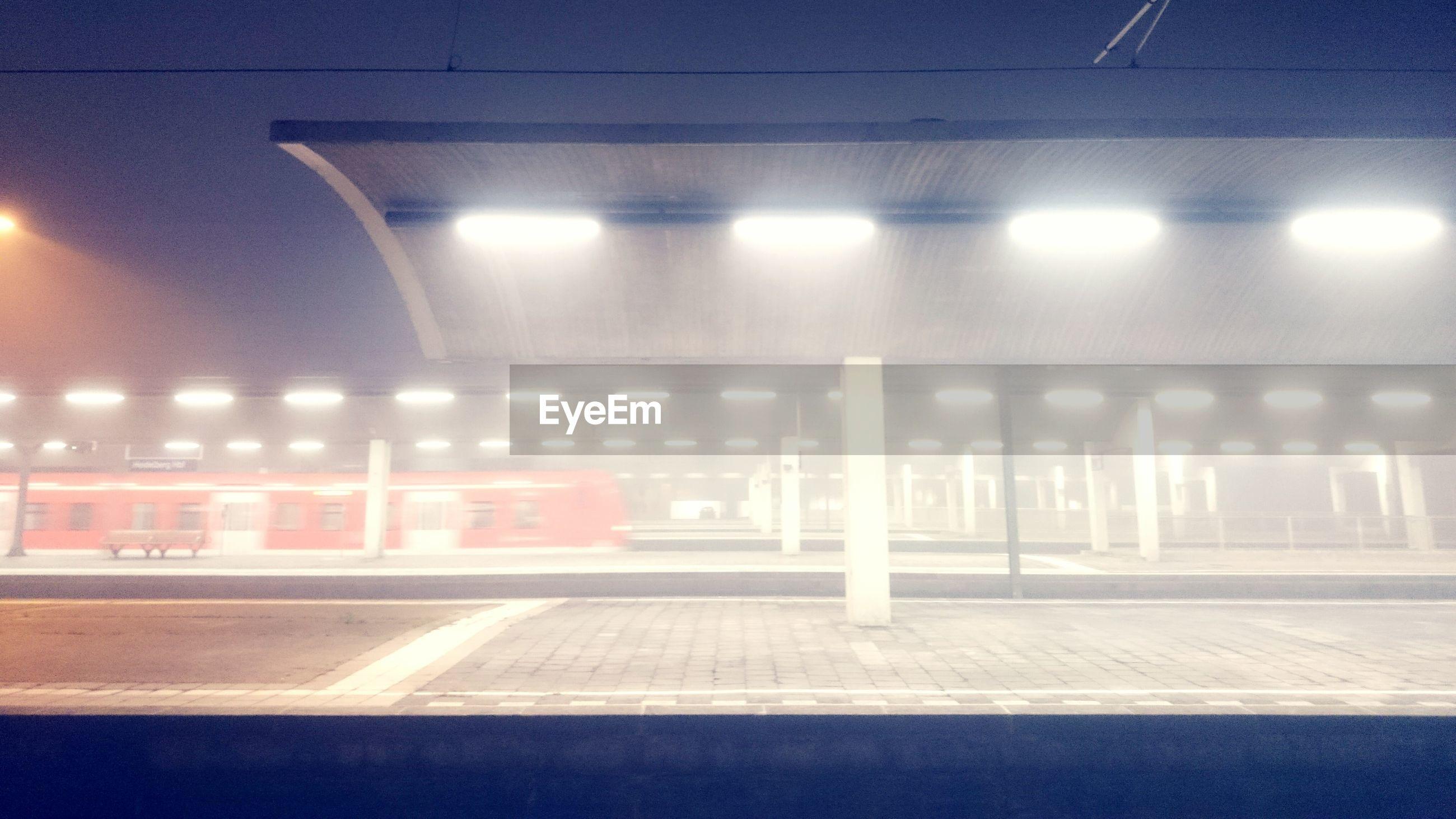 Illuminated railway station at night