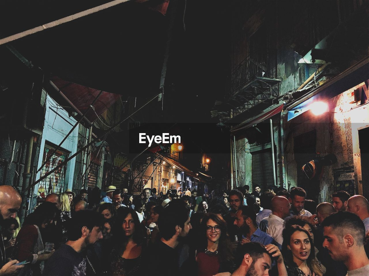 large group of people, crowd, night, illuminated, men, building exterior, architecture, built structure, city, women, real people, outdoors, people, adult