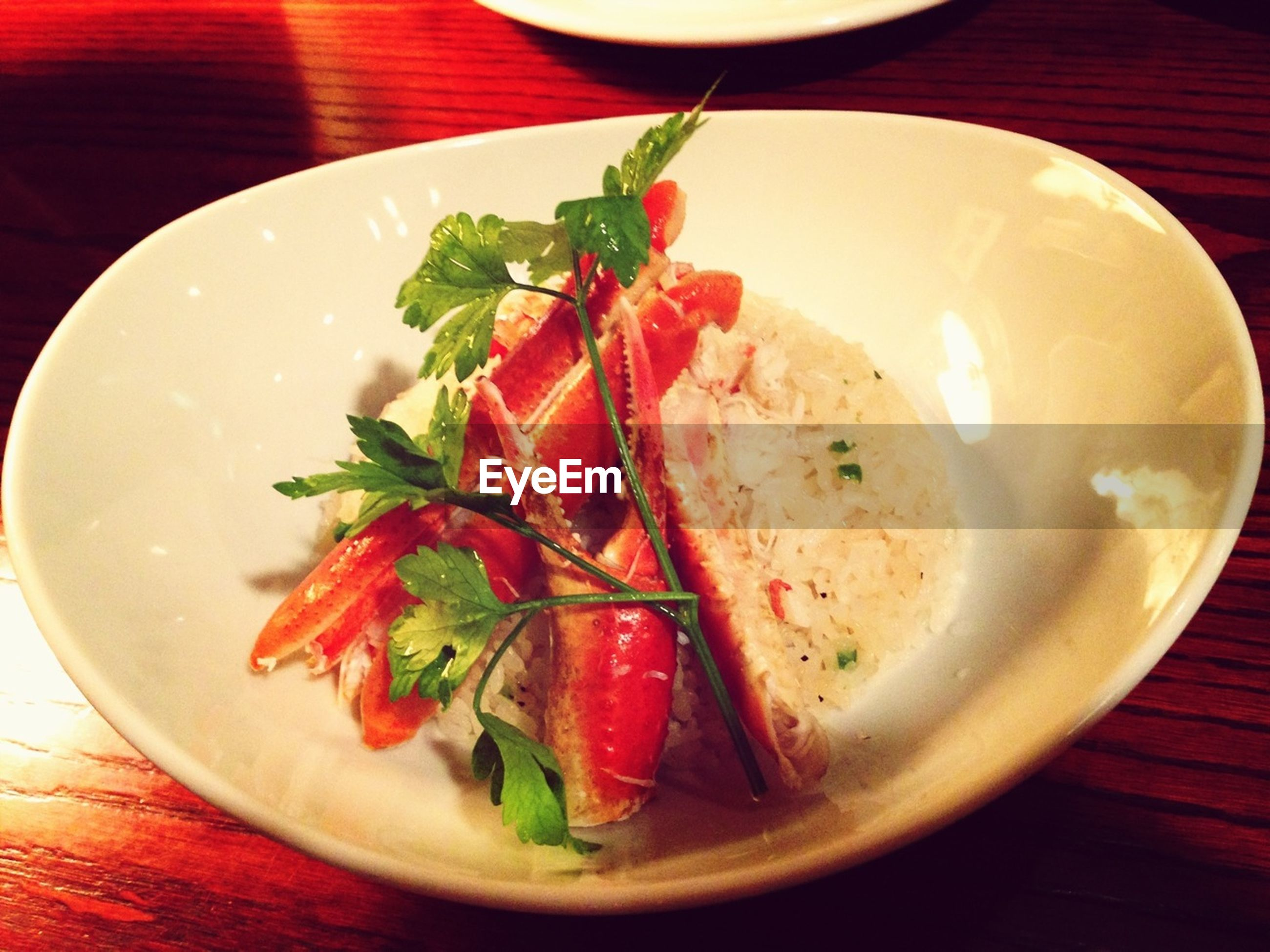 Crab served with rice in restaurant