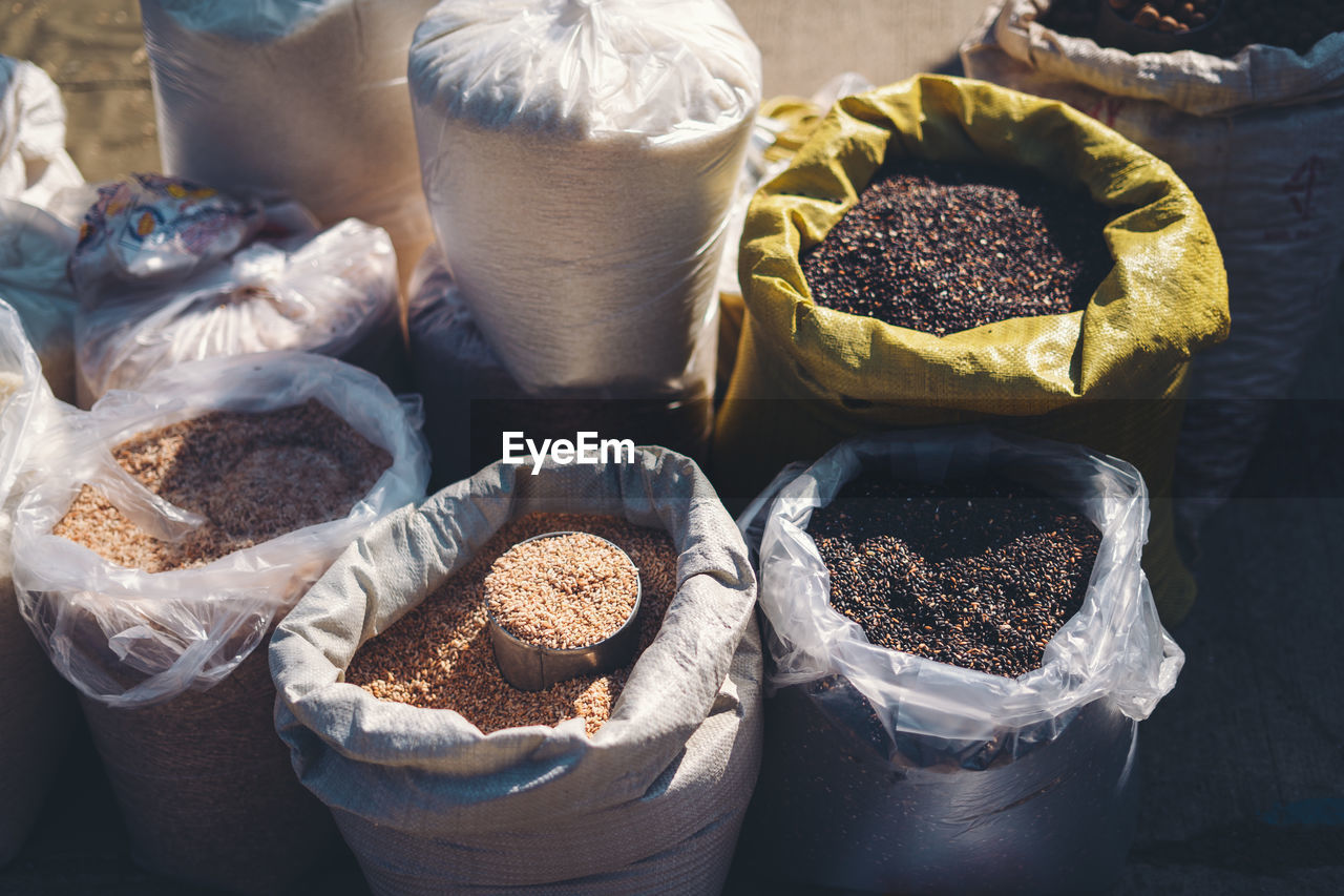 High angle view of various food grain for sale in market
