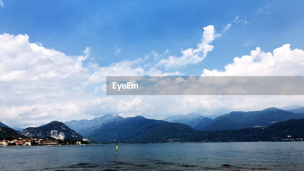 mountain, sky, scenics, cloud - sky, mountain range, water, tranquility, beauty in nature, nature, day, outdoors, tranquil scene, no people, blue, travel destinations