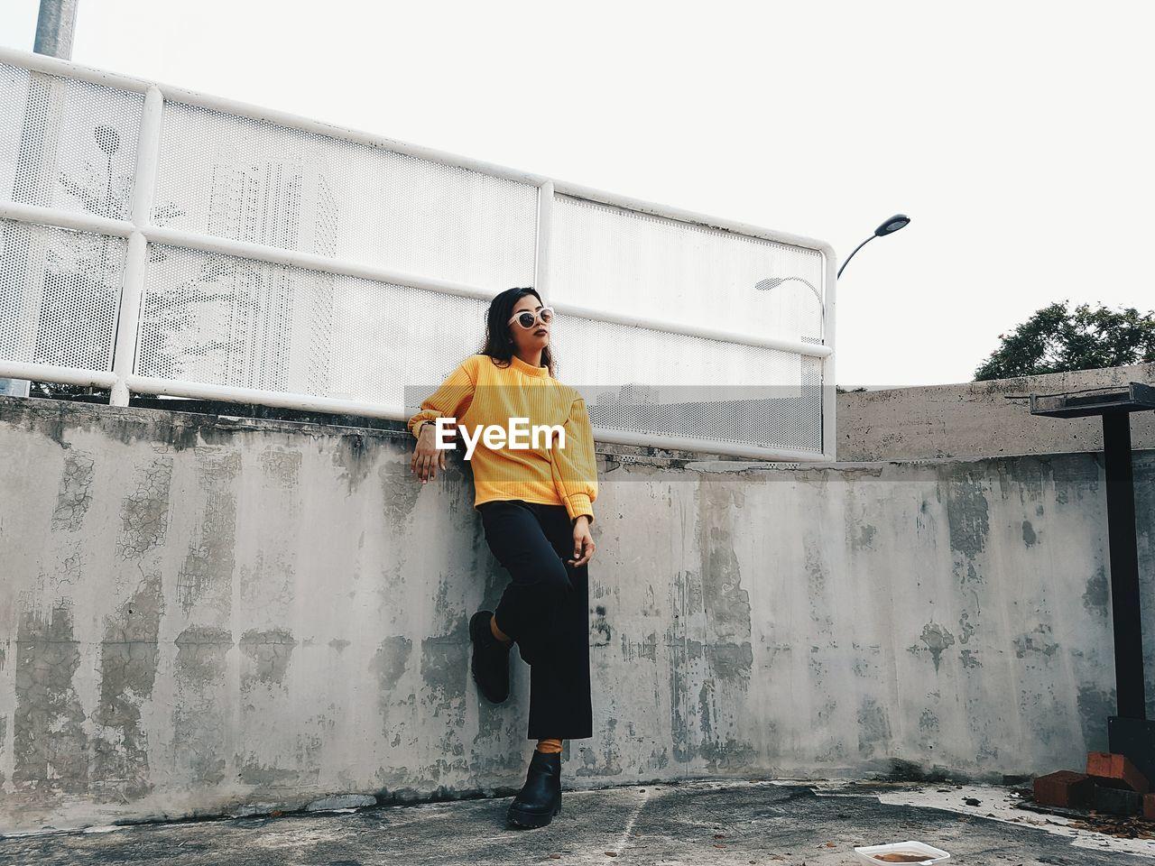 Full Length Of Woman In Yellow Sweater