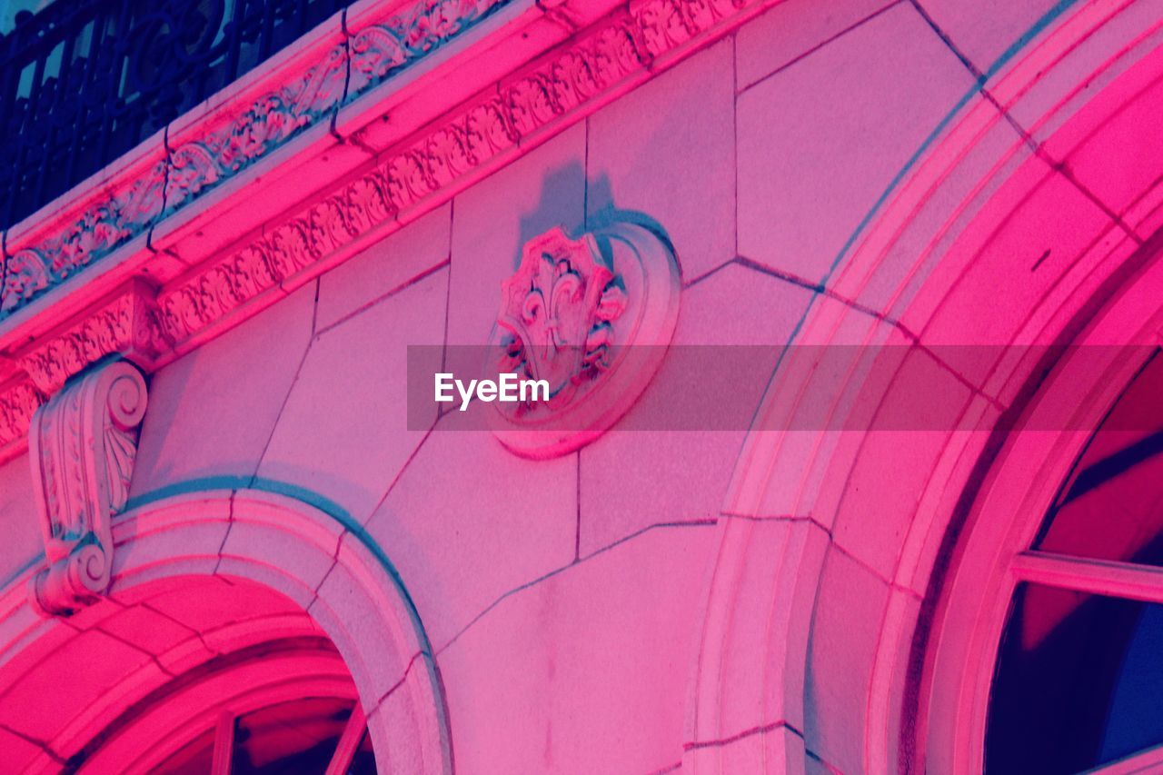 pink color, no people, full frame, red, pattern, close-up, backgrounds, architecture, communication, indoors, built structure, creativity, low angle view, text, day, design, safety, arts culture and entertainment, security