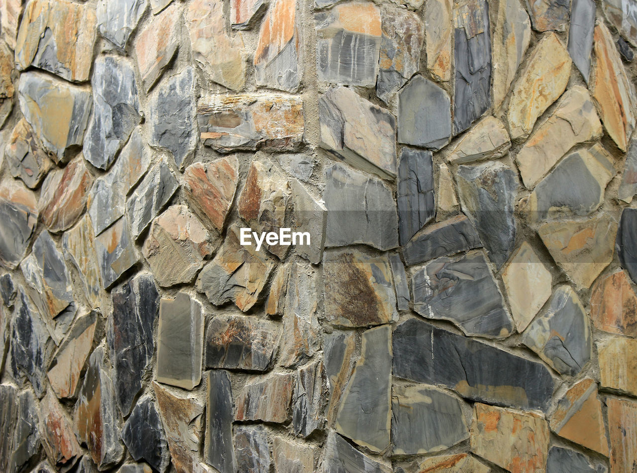 full frame, backgrounds, solid, no people, architecture, pattern, built structure, stone material, wall - building feature, rock, close-up, textured, rock - object, gray, stone wall, history, wall, outdoors, day, ancient