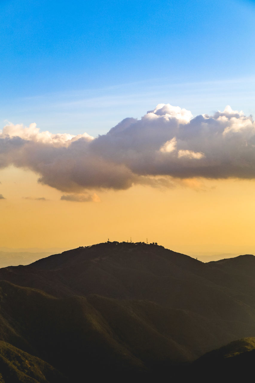 sky, scenics - nature, beauty in nature, cloud - sky, tranquility, sunset, tranquil scene, environment, mountain, landscape, nature, silhouette, idyllic, non-urban scene, no people, orange color, outdoors, sunlight, remote, mountain range