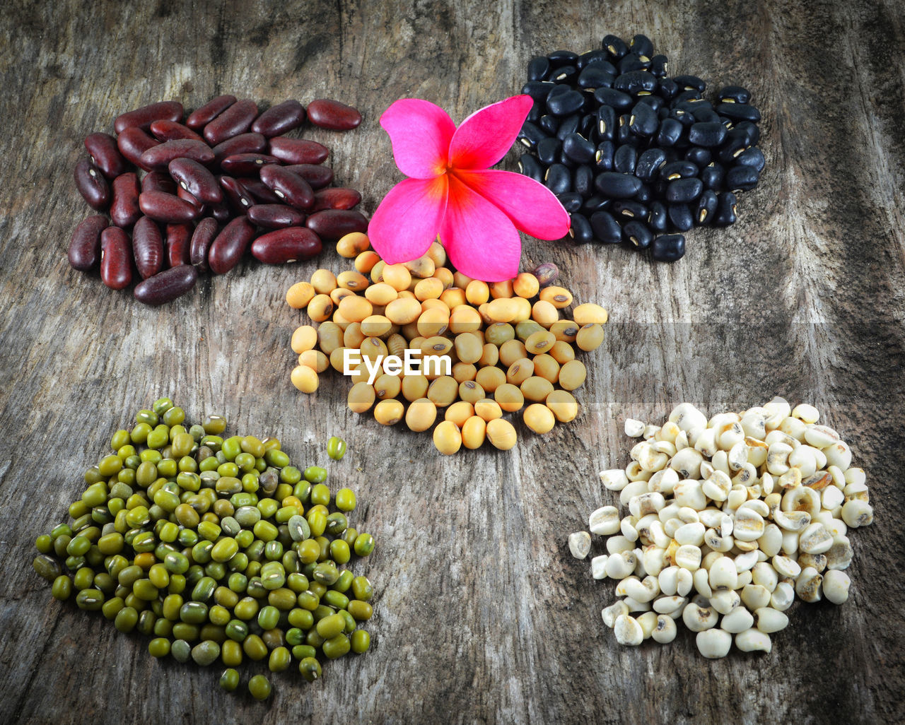 freshness, food and drink, food, no people, large group of objects, indoors, wood - material, still life, table, directly above, wellbeing, close-up, plant, high angle view, choice, healthy eating, nature, variation, seed, raw food, vegetarian food, legume family