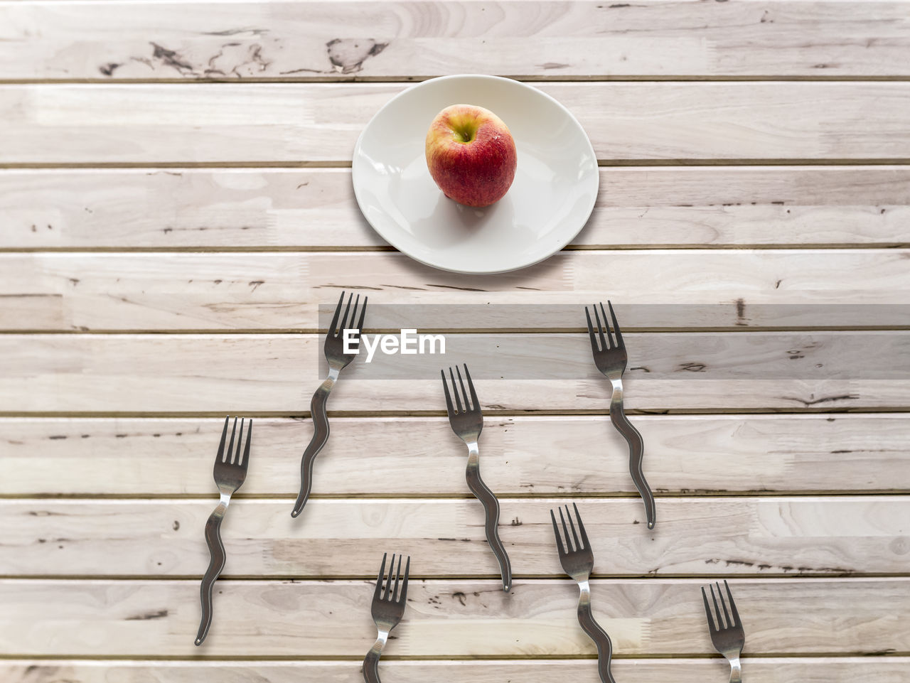 kitchen utensil, eating utensil, fork, table, wood - material, food and drink, food, freshness, still life, high angle view, indoors, plate, directly above, wellbeing, fruit, no people, healthy eating, household equipment, spoon, refreshment, table knife, breakfast, crockery, temptation