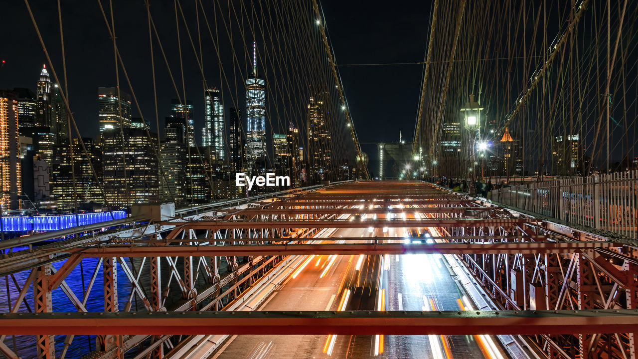 architecture, built structure, night, illuminated, building exterior, city, bridge - man made structure, bridge, connection, transportation, skyscraper, building, no people, travel destinations, office building exterior, tower, nature, motion, tall - high, light trail, outdoors, modern, cityscape