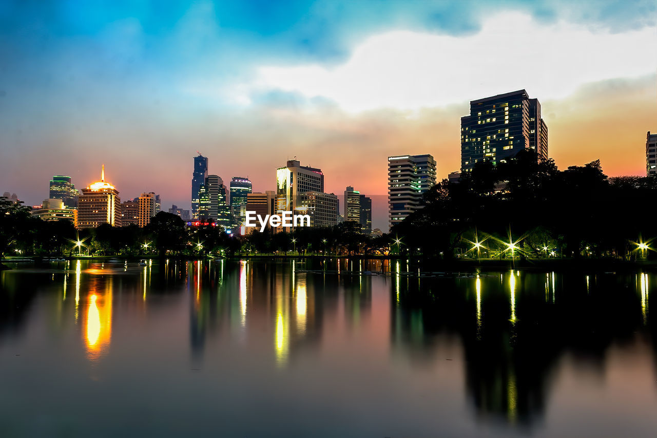 building exterior, architecture, built structure, water, sky, reflection, building, city, illuminated, waterfront, nature, no people, cloud - sky, urban skyline, office building exterior, river, modern, landscape, outdoors, cityscape, skyscraper, financial district