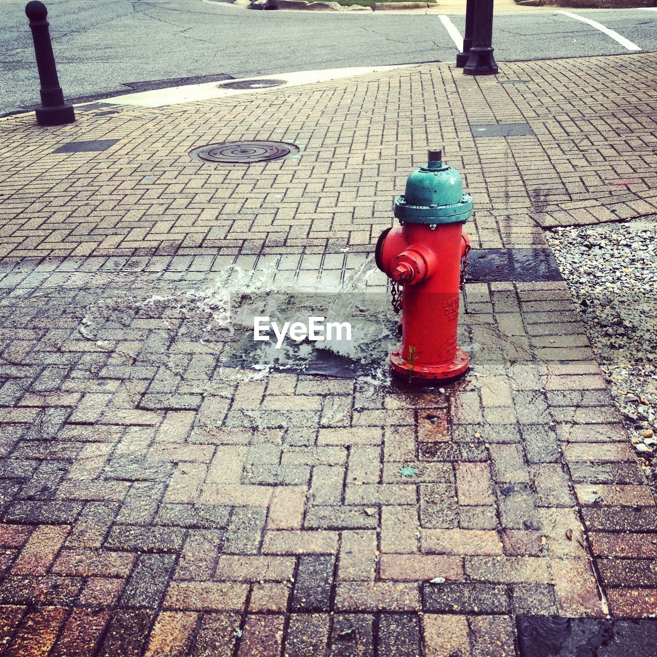 cobblestone, fire hydrant, safety, outdoors, day, protection, street, sidewalk, red, stone tile, no people, water