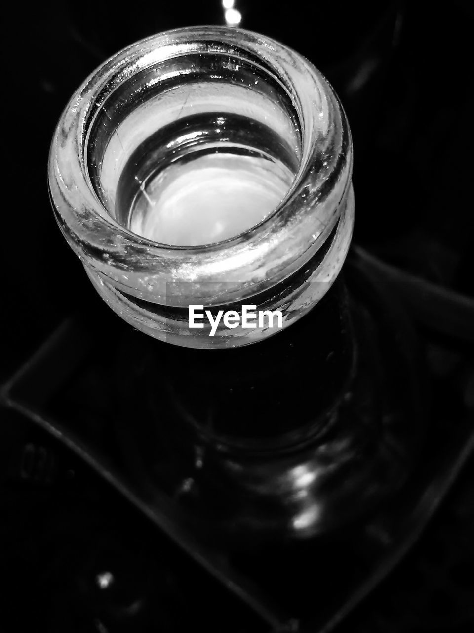 glass - material, indoors, close-up, still life, container, high angle view, bottle, no people, focus on foreground, transparent, table, single object, glass, food and drink, selective focus, household equipment, refreshment, empty, drink
