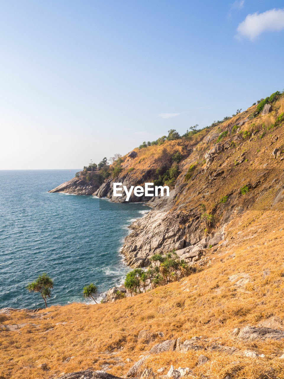 sea, sky, water, land, scenics - nature, beauty in nature, beach, nature, tranquility, tranquil scene, clear sky, no people, cliff, rock, day, copy space, horizon, mountain, rock - object, outdoors, horizon over water, rocky coastline