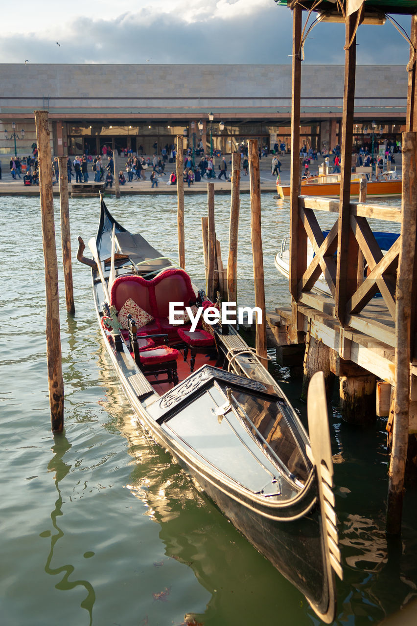 water, nautical vessel, mode of transportation, transportation, moored, nature, wooden post, day, sea, architecture, wood - material, travel, post, gondola - traditional boat, sky, travel destinations, built structure, waterfront, no people, canal, outdoors
