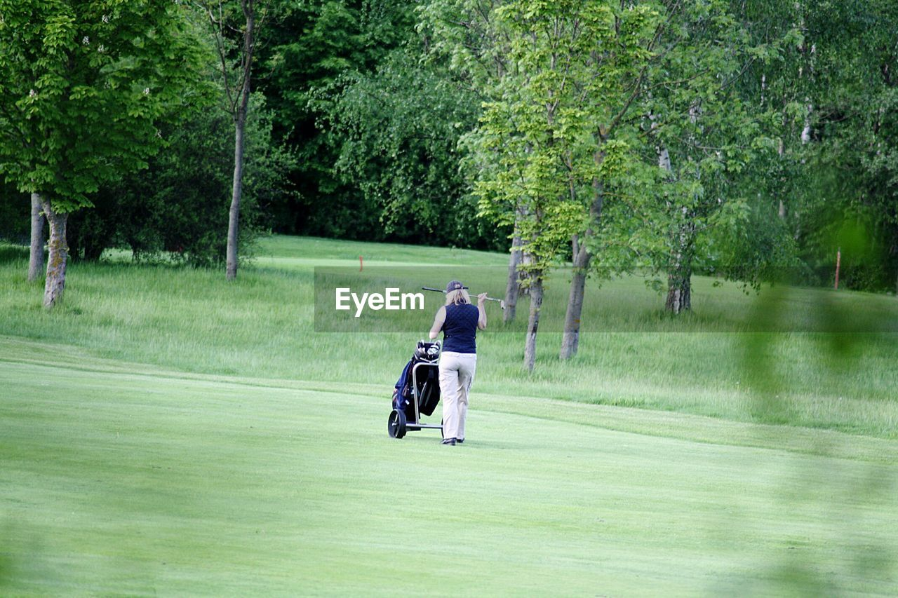 Rear View Of Woman On Golf Course