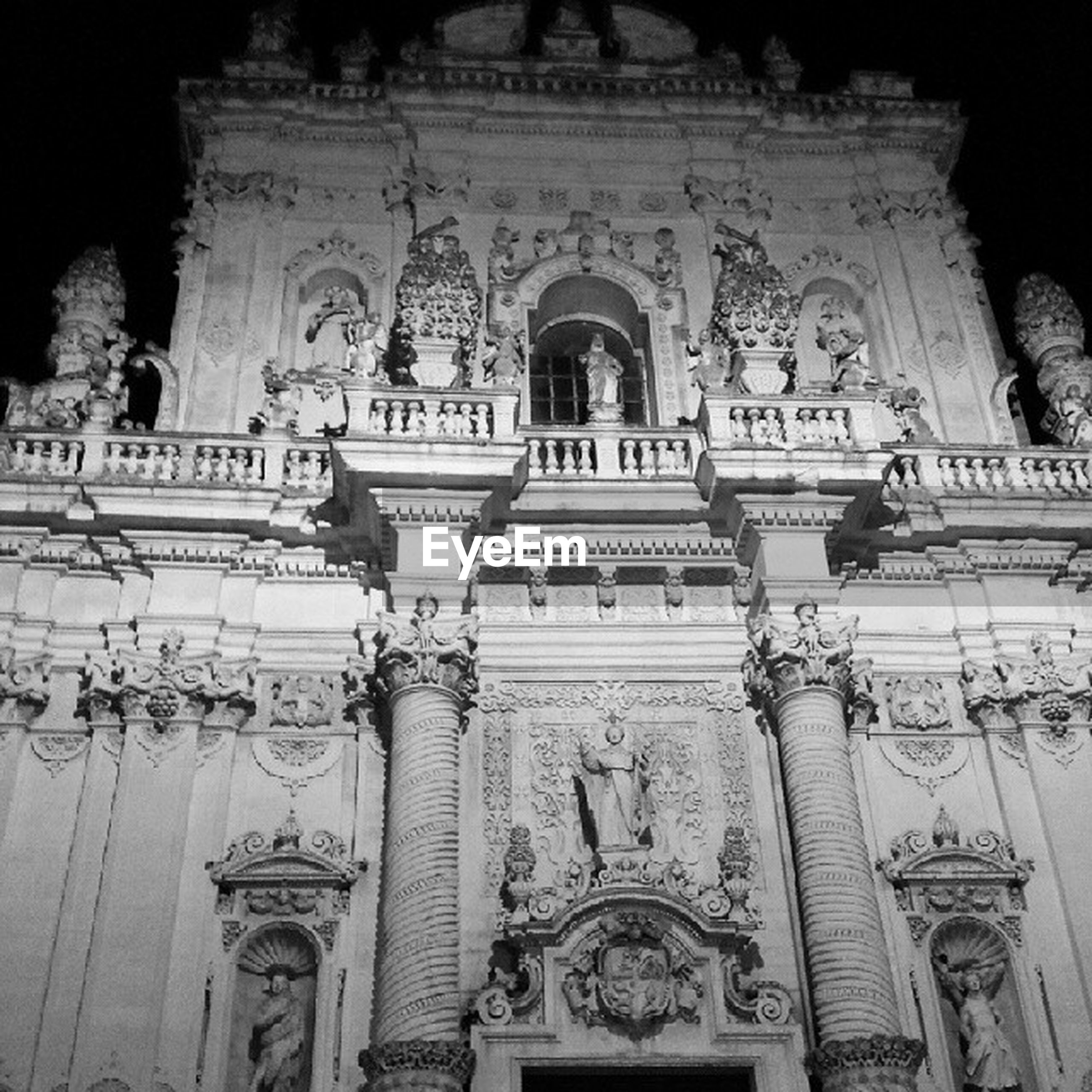 architecture, built structure, low angle view, art and craft, building exterior, art, statue, human representation, creativity, arch, carving - craft product, sculpture, religion, place of worship, history, ornate, spirituality, church