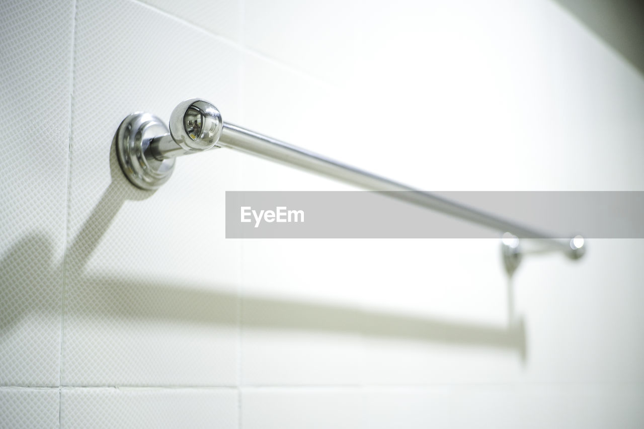 HIGH ANGLE VIEW OF FAUCET