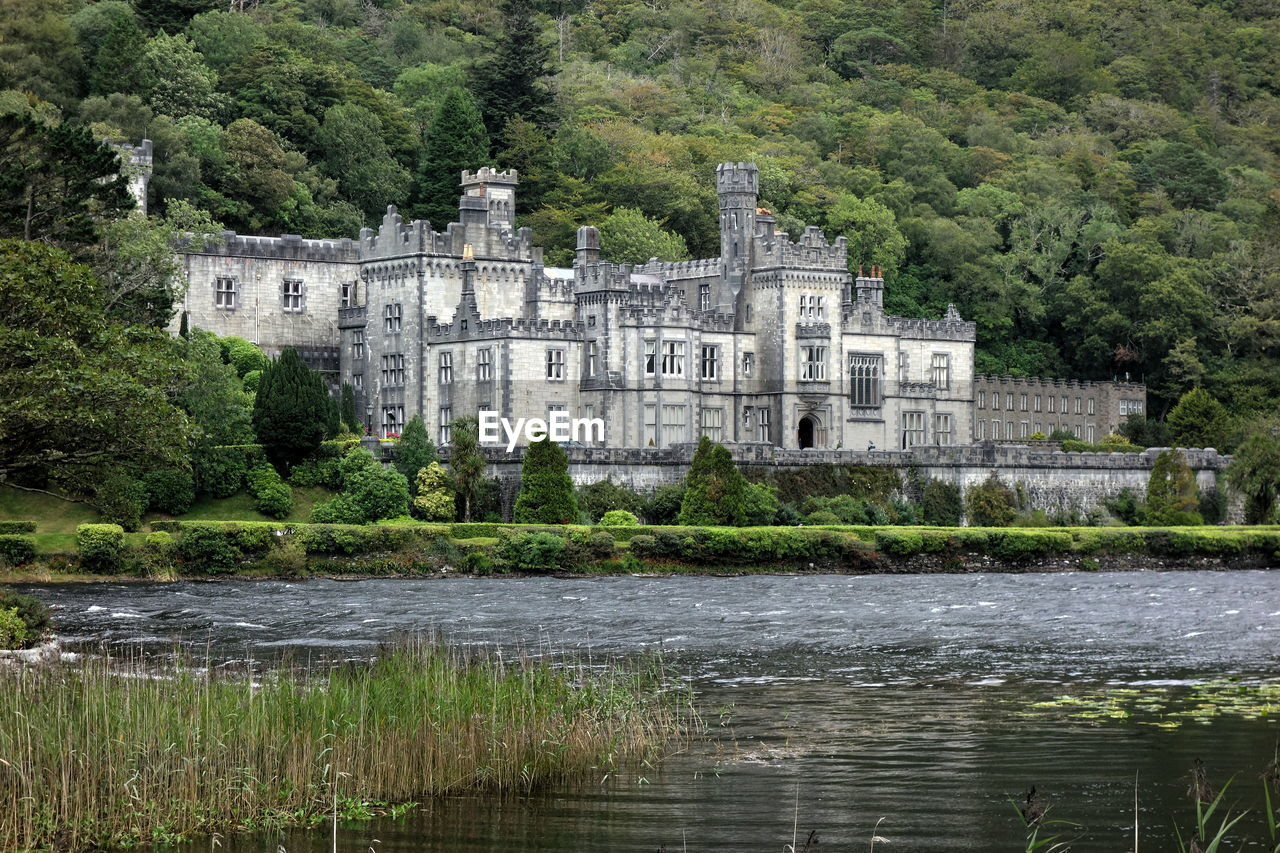 water, architecture, built structure, building exterior, nature, the past, plant, history, tree, castle, travel destinations, building, no people, lake, mansion, day, house, residential district, outdoors