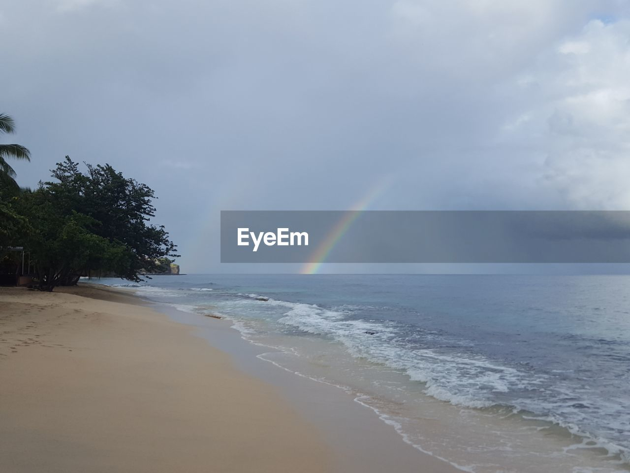 rainbow, sea, double rainbow, beauty in nature, scenics, nature, sky, water, cloud - sky, beach, idyllic, no people, tranquil scene, outdoors, horizon over water, day, motion, wave