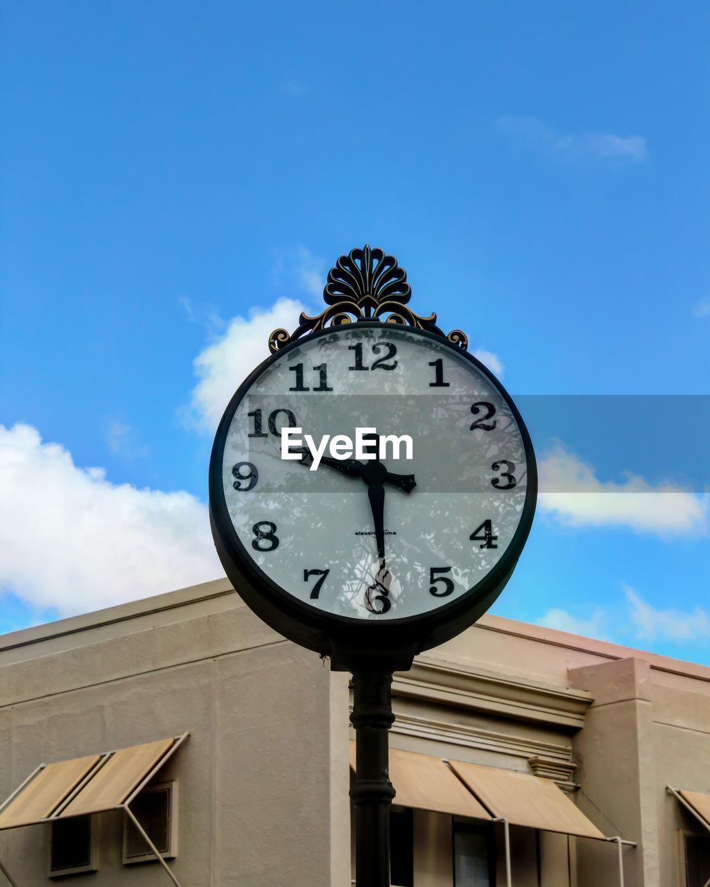 low angle view, clock, time, building exterior, sky, architecture, built structure, day, cloud - sky, outdoors, no people, blue, minute hand, clock face, close-up