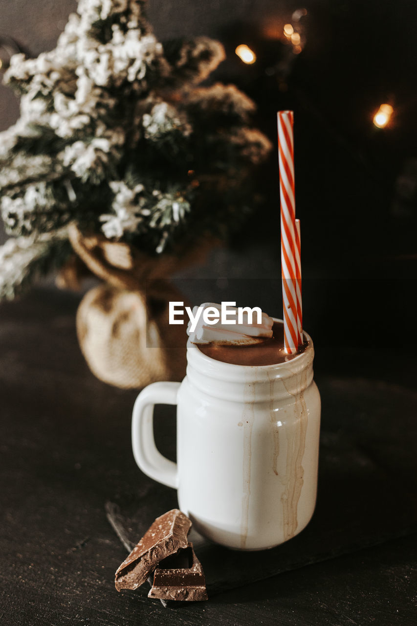 CLOSE-UP OF COFFEE CUP ON TABLE AT CHRISTMAS