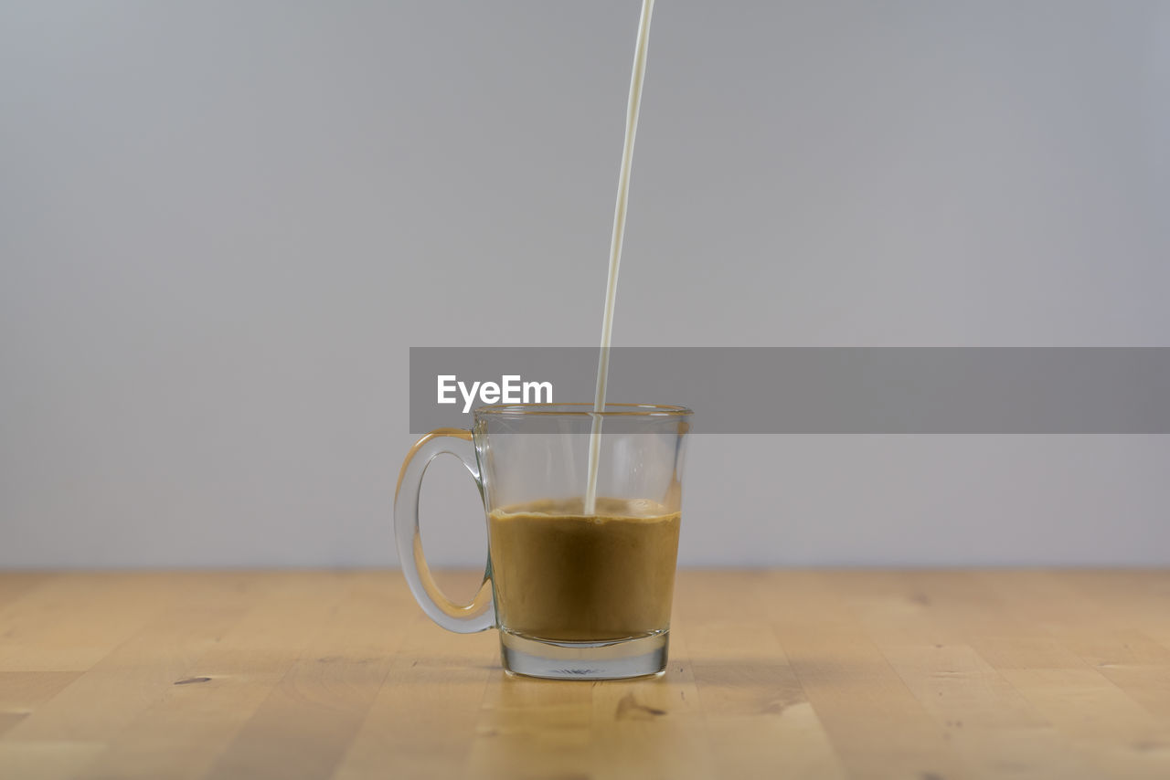 drink, refreshment, food and drink, cup, mug, table, indoors, freshness, still life, coffee, close-up, glass, tea, hot drink, transparent, drinking glass, coffee - drink, pouring, food, no people, crockery, tea cup