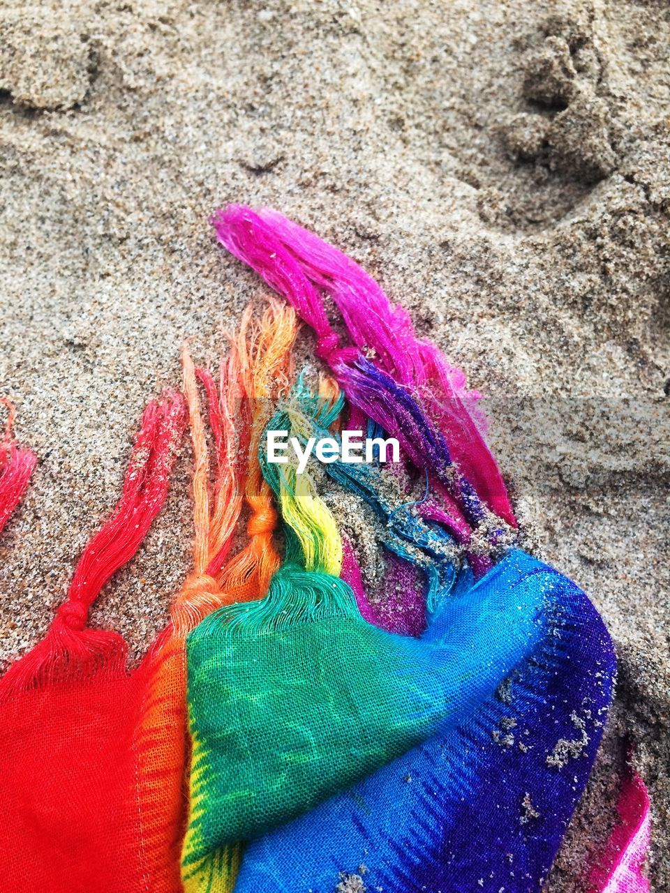 high angle view, multi colored, day, no people, outdoors, sand, beach, powder paint, close-up, holi