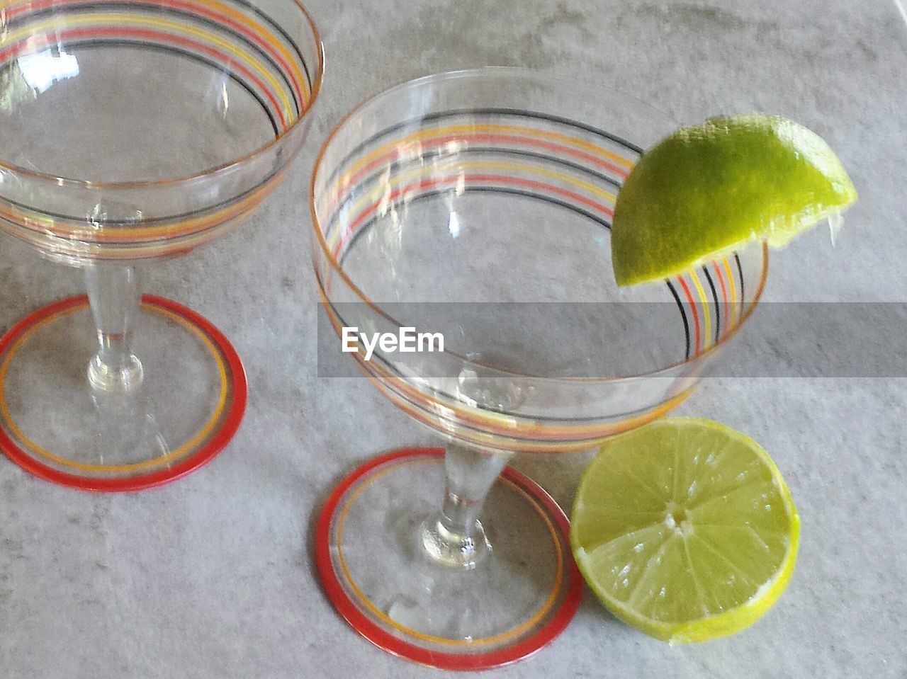 alcohol, drinking glass, cocktail, food and drink, lime, drink, high angle view, refreshment, no people, slice, freshness, shot glass, indoors, martini glass, close-up, tequila - drink, martini, day