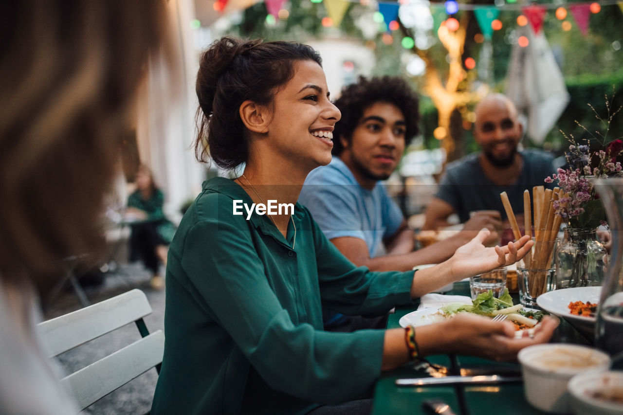 food and drink, smiling, happiness, group of people, lifestyles, togetherness, drink, event, men, women, celebration, leisure activity, emotion, mid adult men, males, party - social event, friendship, adult, mid adult, real people, social gathering, glass, mature adult, mature men, drinking, meal