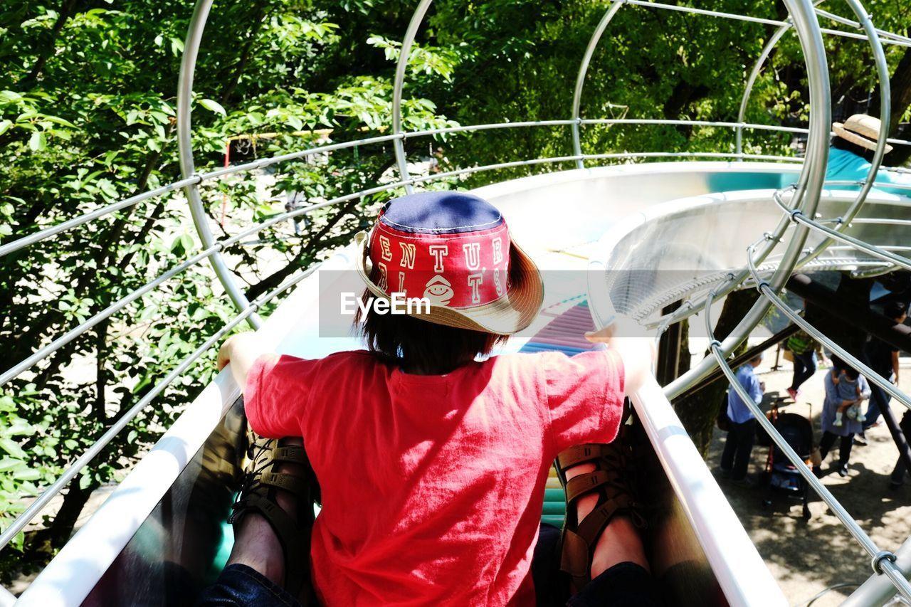 Rear View Of Boy On Slide