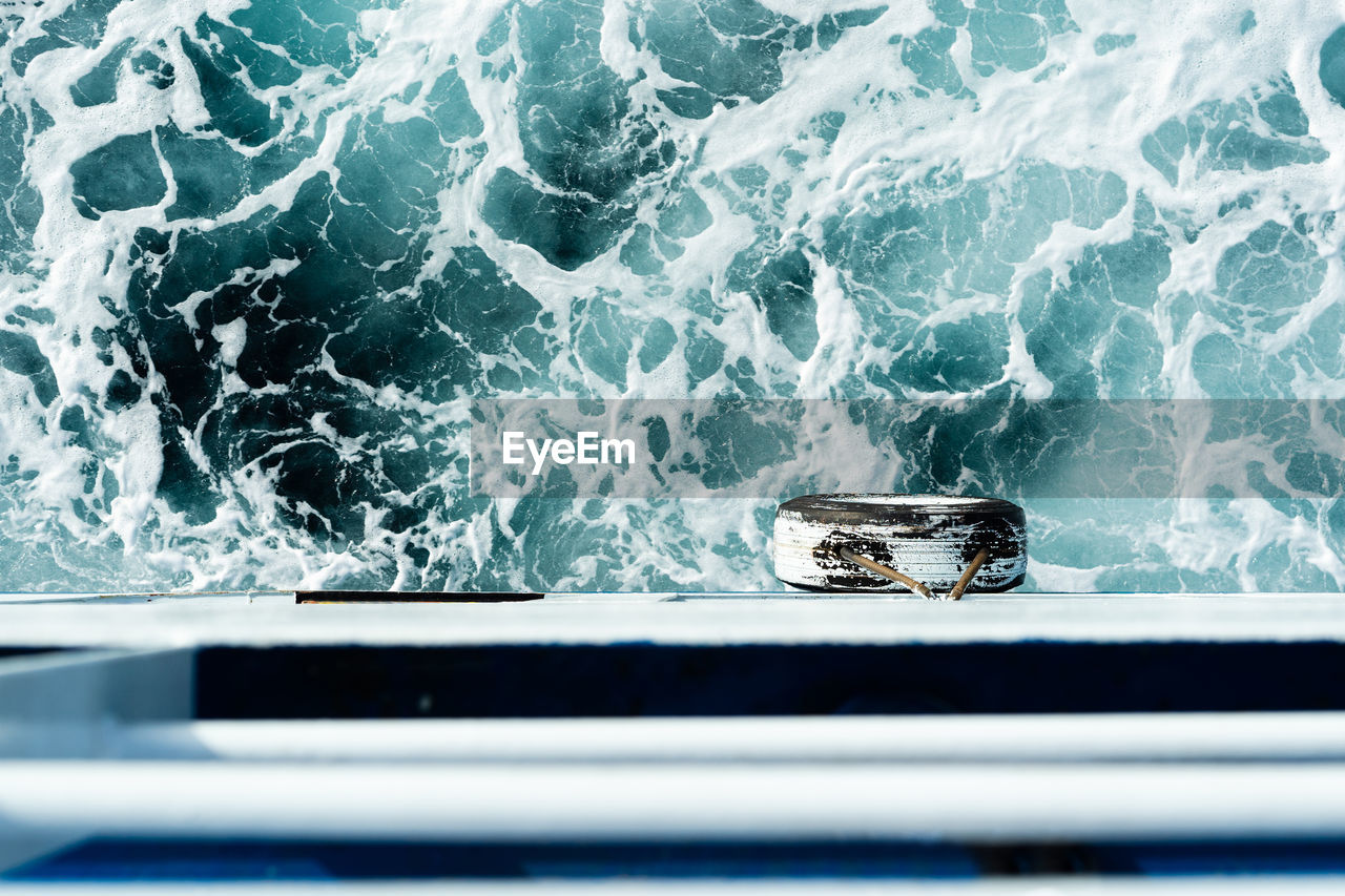 nautical vessel, sea, water, mode of transportation, transportation, no people, nature, day, motion, one animal, outdoors, close-up, blue, animal, animal themes, wave, aquatic sport, high angle view, wheel