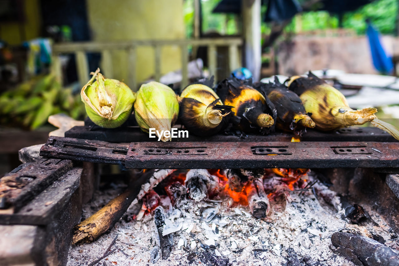 food, food and drink, healthy eating, heat - temperature, freshness, wellbeing, no people, fruit, burning, focus on foreground, fire, day, flame, close-up, barbecue, fire - natural phenomenon, nature, wood - material, outdoors, metal, wood
