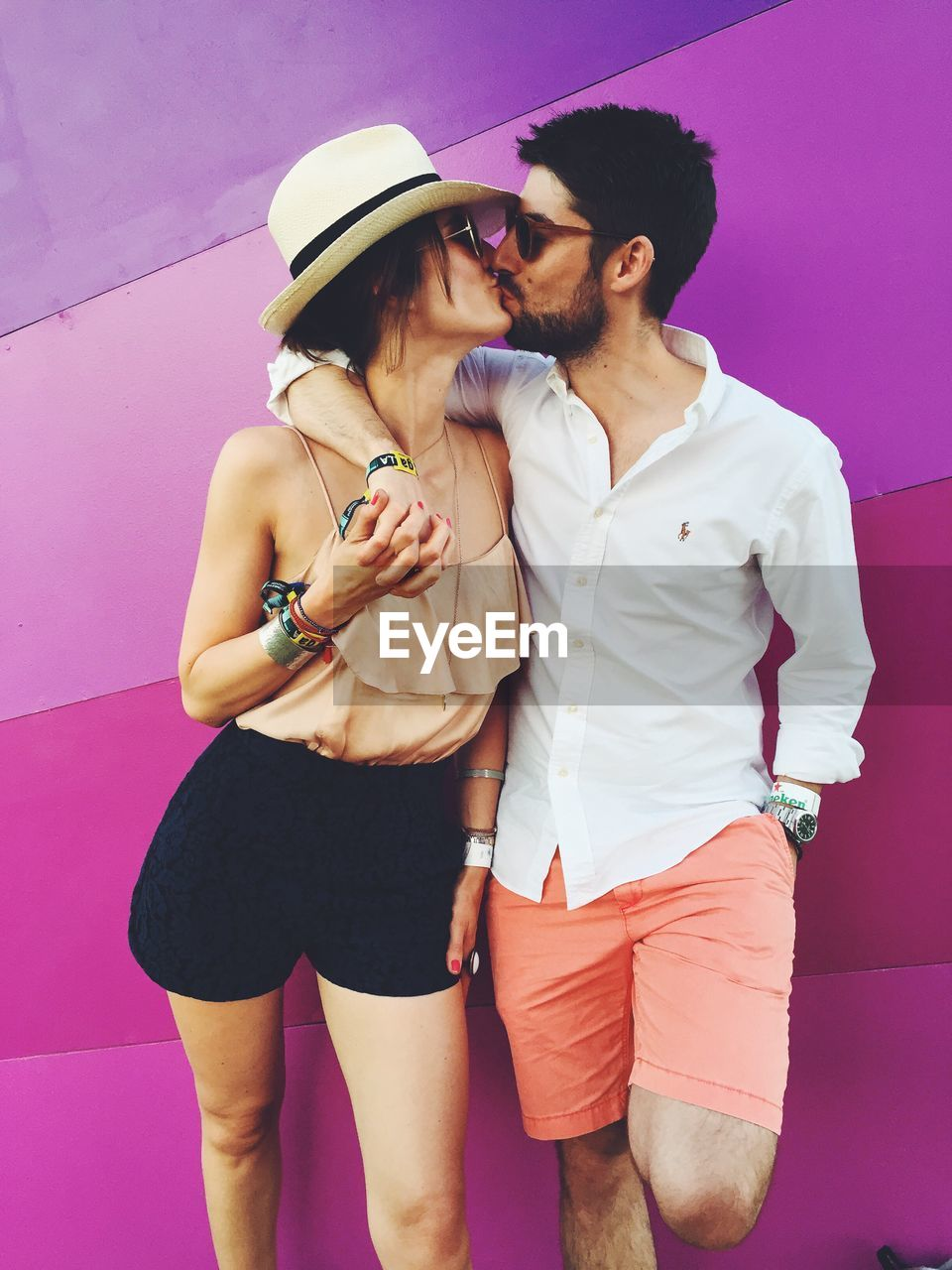 love, two people, real people, three quarter length, togetherness, bonding, kissing, casual clothing, young women, young adult, leisure activity, pink color, couple - relationship, lifestyles, embracing, standing, happiness, day