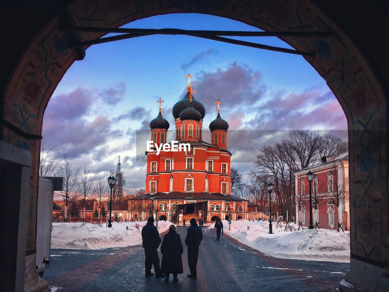architecture, built structure, building exterior, winter, cold temperature, sky, building, snow, city, cloud - sky, nature, arch, group of people, real people, adult, women, place of worship, day, religion, outdoors