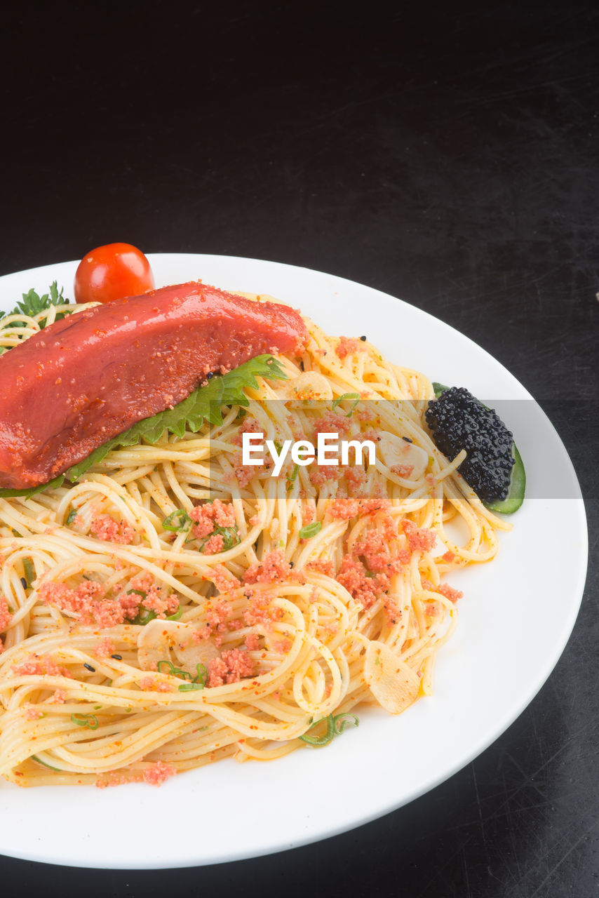 food and drink, food, noodles, freshness, ready-to-eat, no people, healthy eating, studio shot, vegetable, indoors, plate, garnish, serving size, italian food, close-up, black background
