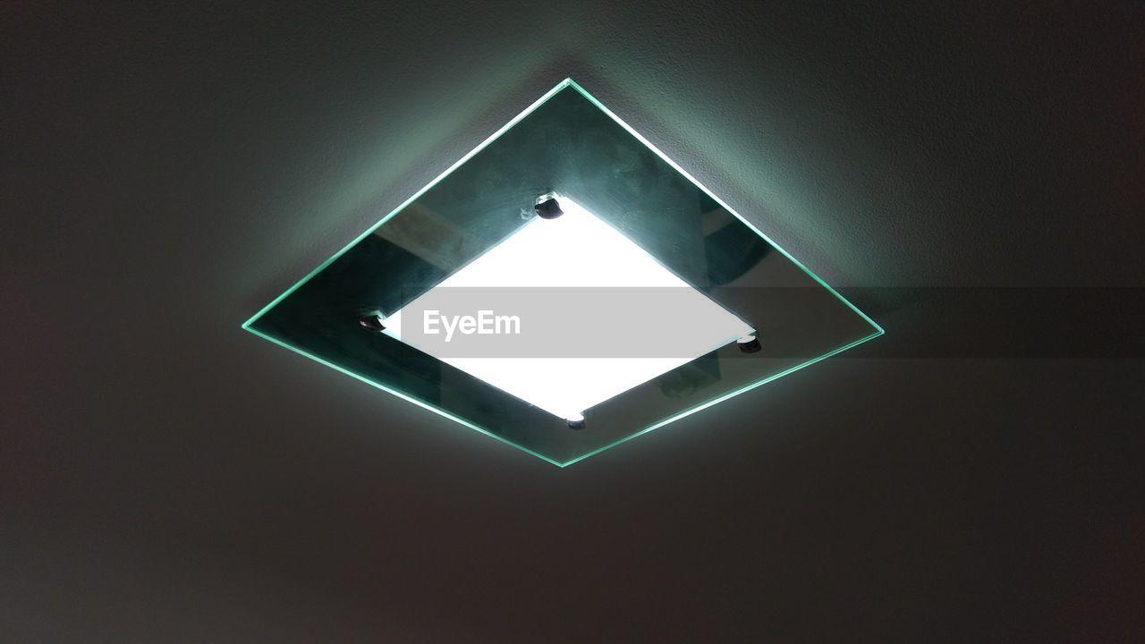 Low angle view of illuminated light