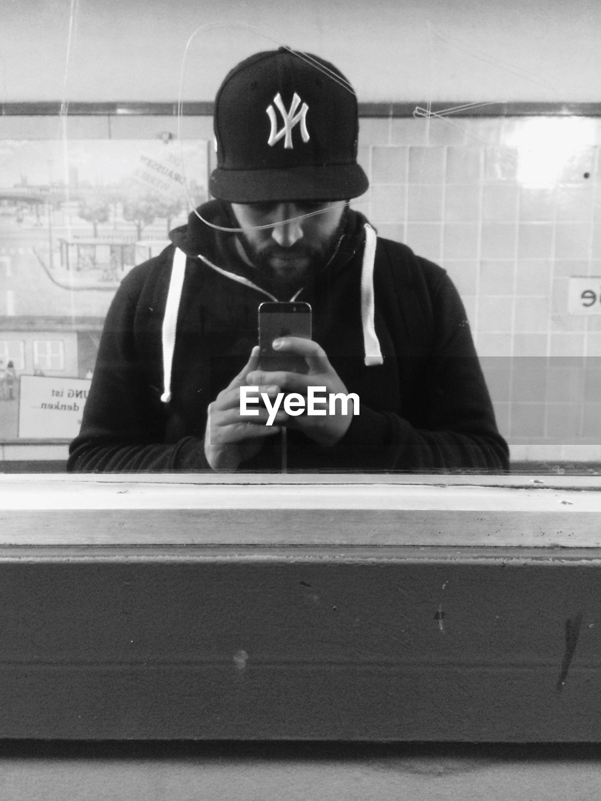 Man taking selfie in front of mirror at bathroom