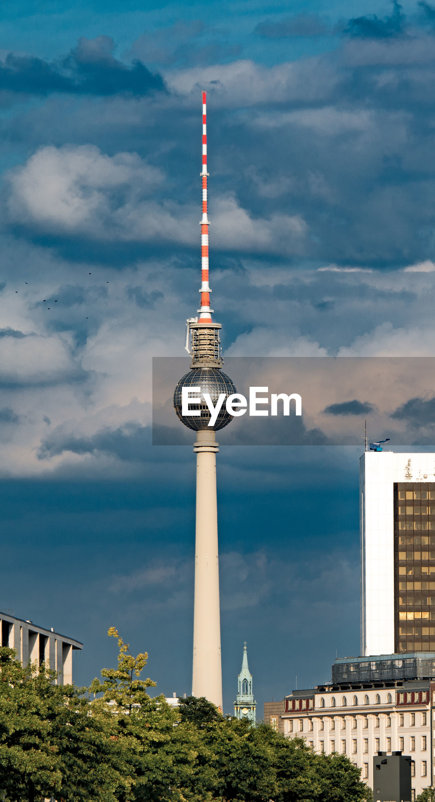 View of berlin tv tower against cloudy sky