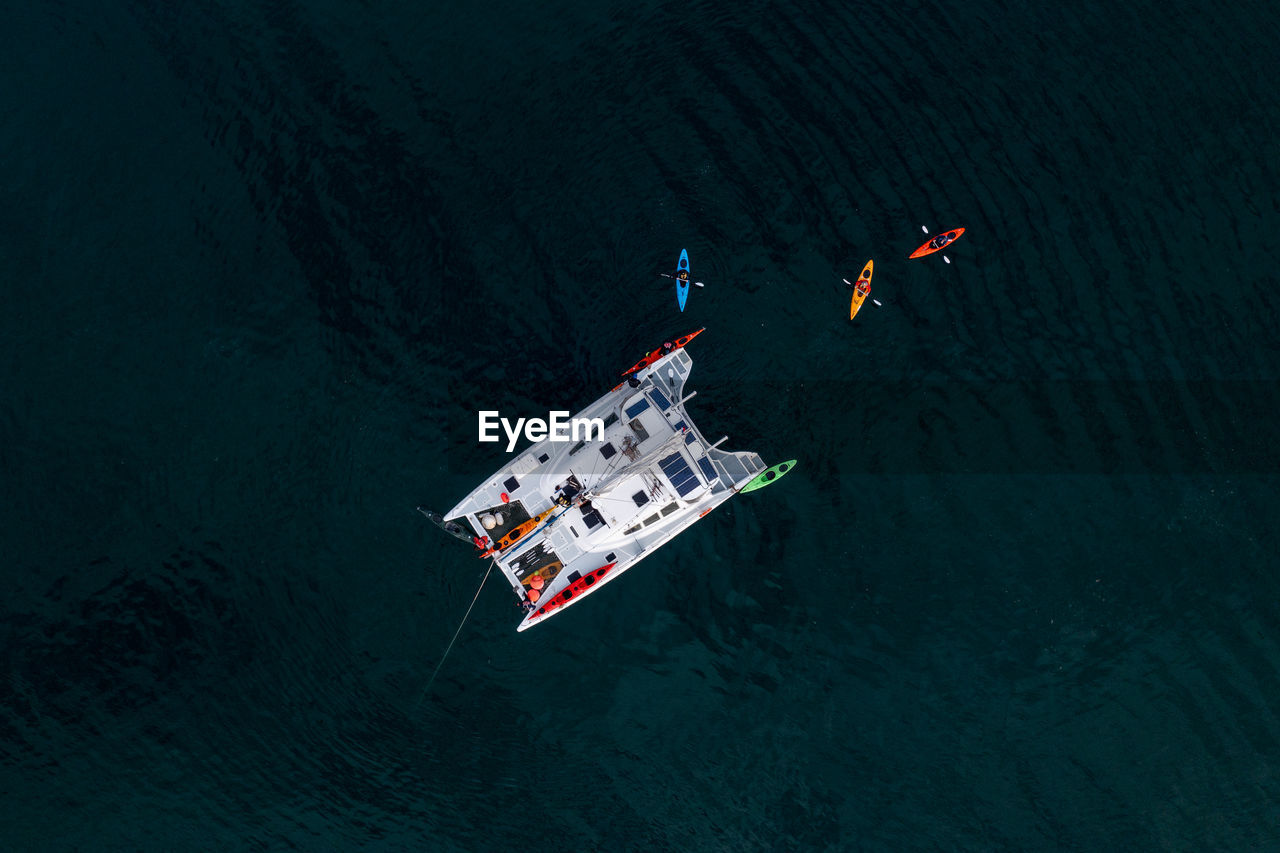 High angle view of people floating on sea