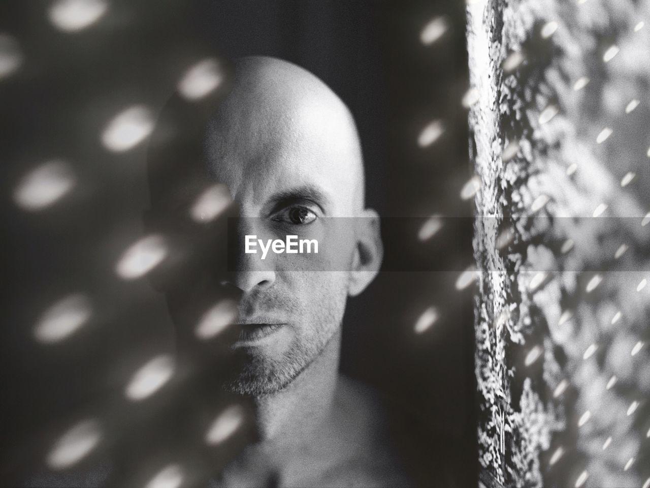 Double Exposure Image Of Bald Man And Lighting Equipment