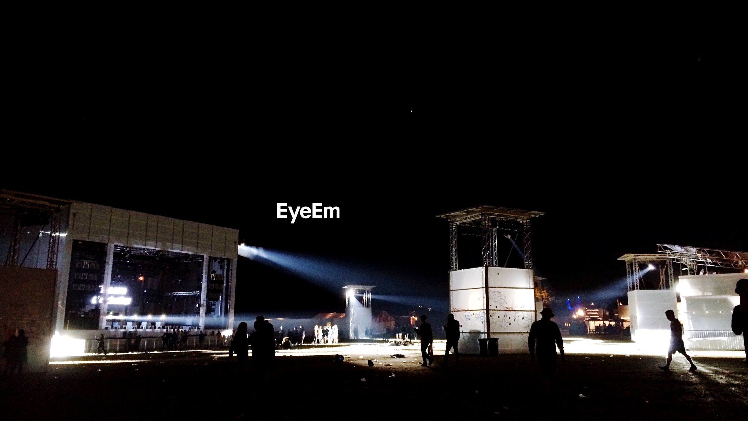 Group of people against built structure at night