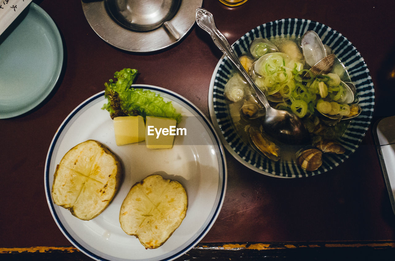 food and drink, healthy eating, food, freshness, plate, indoors, high angle view, ready-to-eat, bowl, table, banana, slice, no people, serving size, fruit, close-up, day