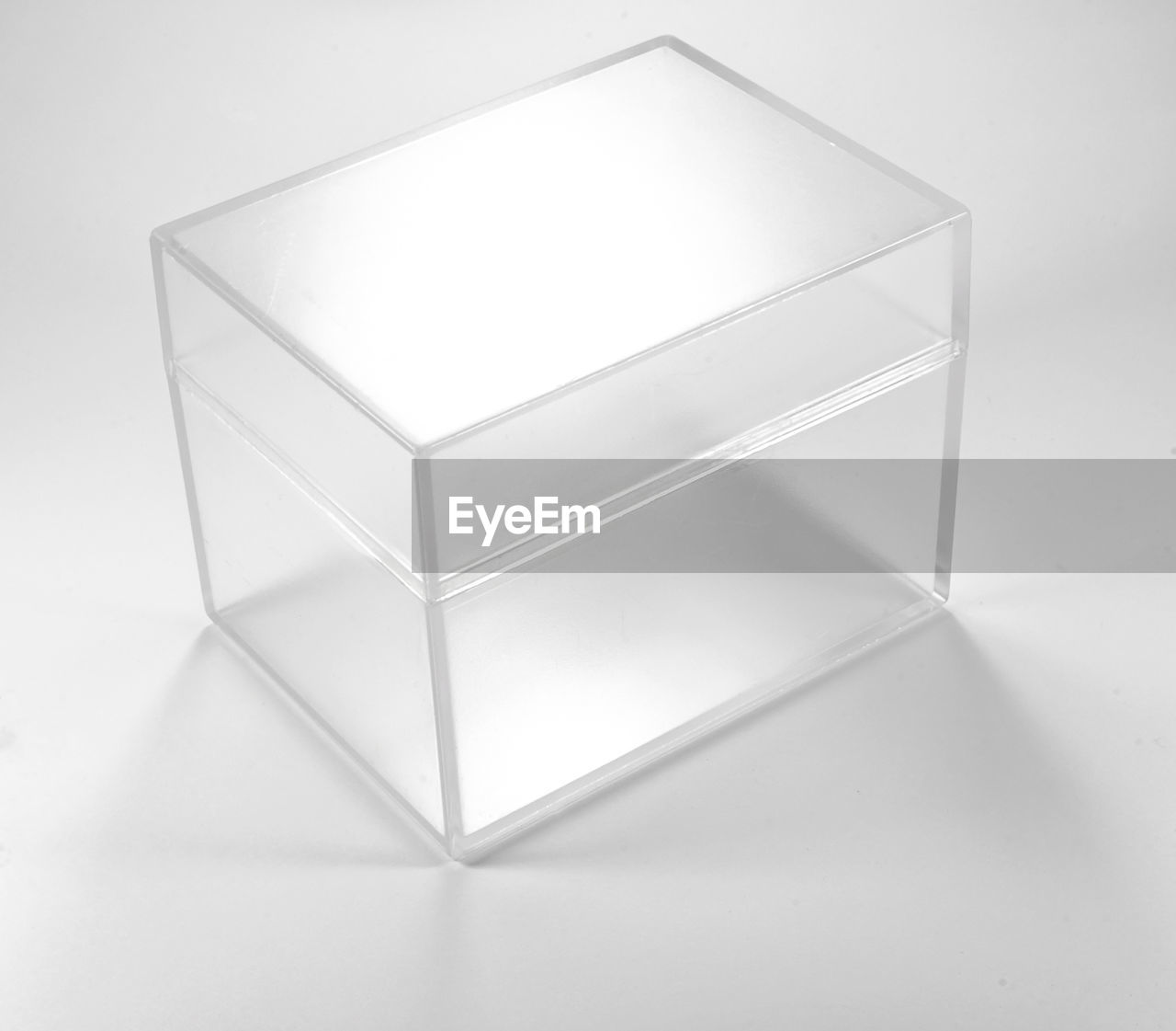 container, no people, white color, indoors, box, box - container, still life, studio shot, white background, close-up, single object, shape, geometric shape, pattern, cube shape, high angle view, design, glass - material, simplicity, empty, silver colored